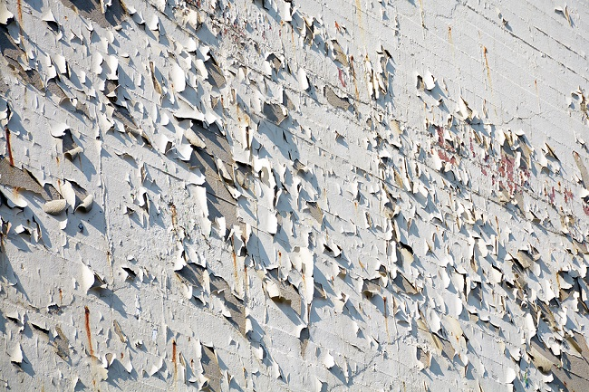 House Wall With Flaking Paint